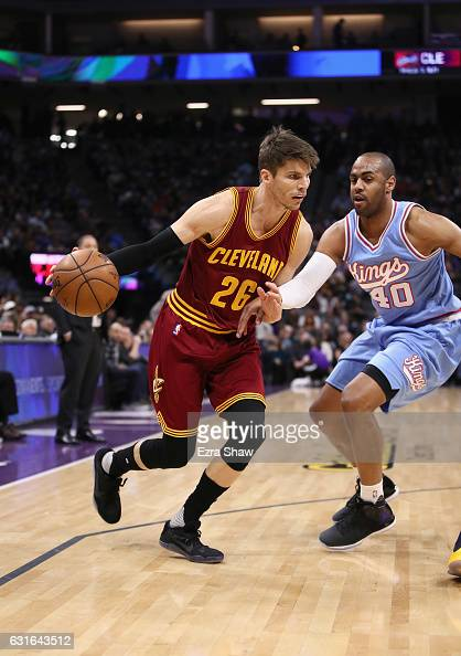 Kyle Korver of the Cleveland Cavaliers drives on Arron Afflalo of the Sacramento Kings at Golden 1 Center on January 13 2017 in Sacramento California...