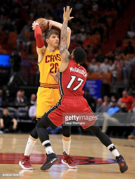 Kyle Korver of the Cleveland Cavaliers is guarded by Rodney McGruder of the Miami Heat during a game at American Airlines Arena on March 4 2017 in...