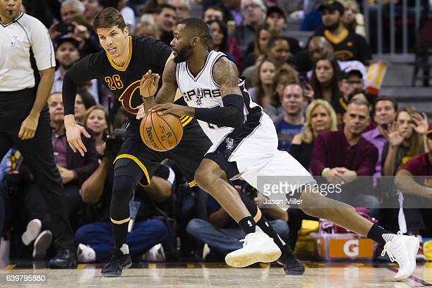 Kyle Korver of the Cleveland Cavaliers puts pressure on Jonathon Simmons of the San Antonio Spurs during the first half at Quicken Loans Arena on...