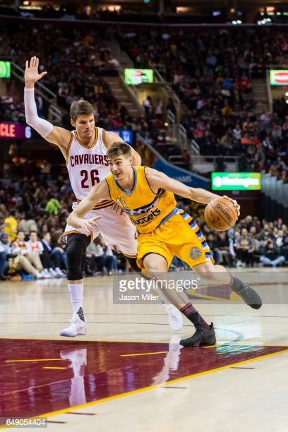 Kyle Korver of the Cleveland Cavaliers puts pressure on Juancho Hernangomez of the Denver Nuggets during the first half at Quicken Loans Arena on...