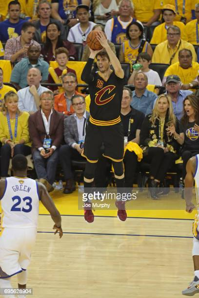Kyle Korver of the Cleveland Cavaliers shoots a three point basket against the Golden State Warriors in Game Five of the 2017 NBA Finals on June 12...