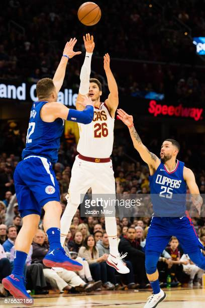 Kyle Korver of the Cleveland Cavaliers shoots a three while under pressure from Blake Griffin and Austin Rivers of the LA Clippers during the second...