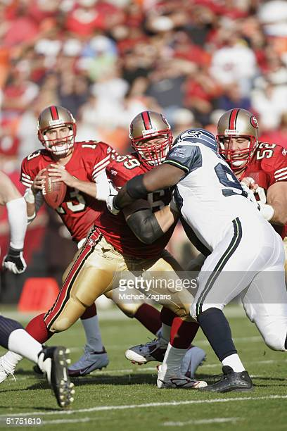 Kyle Kosier and Brock Gutierrez block for Tim Rattay of the San Francisco 49ers against Rocky Bernard of the Seattle Seahawks at Monster Park on...