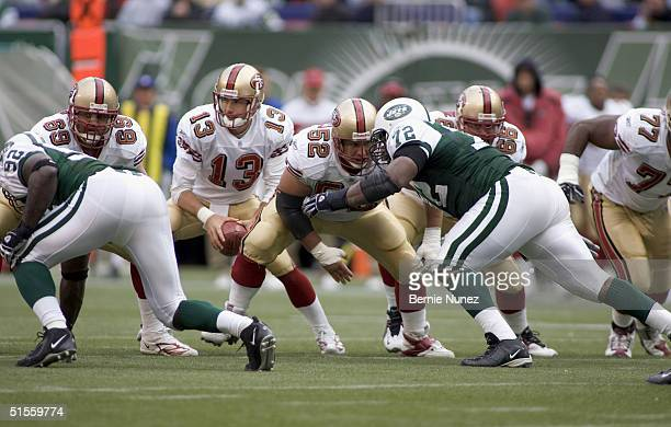 Kyle Kosier C Brock Gutierrez and OG Eric Heitmann of the San Francisco 49ers block for QB Tim Rattay in the game against the New York Jets on...