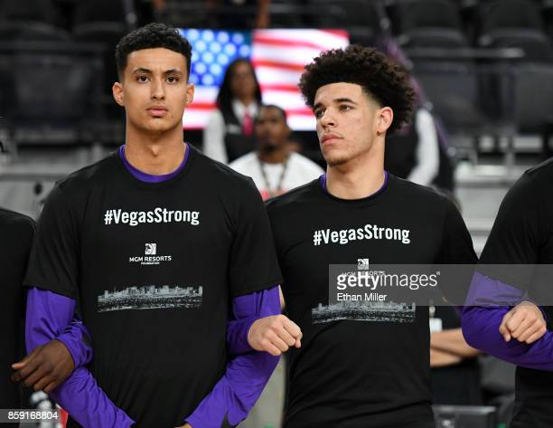 Kyle Kuzma and Lonzo Ball of the Los Angeles Lakers wear #VegasStrong Tshirts as they lock arms during a moment of silence held to honor victims of...
