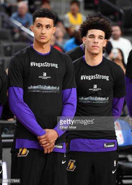 Kyle Kuzma and Lonzo Ball of the Los Angeles Lakers wear #VegasStrong Tshirts to honor victims of last Sunday's mass shooting before their preseason...