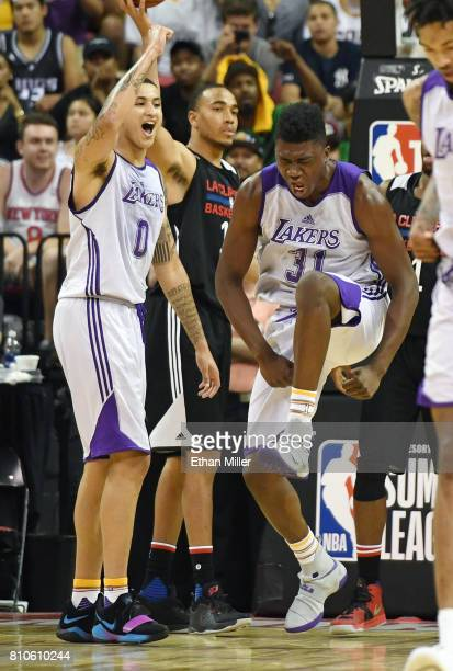 Kyle Kuzma and Thomas Bryant of the Los Angeles Lakers react after Bryant scored against the Los Angeles Clippers and was fouled during the 2017...