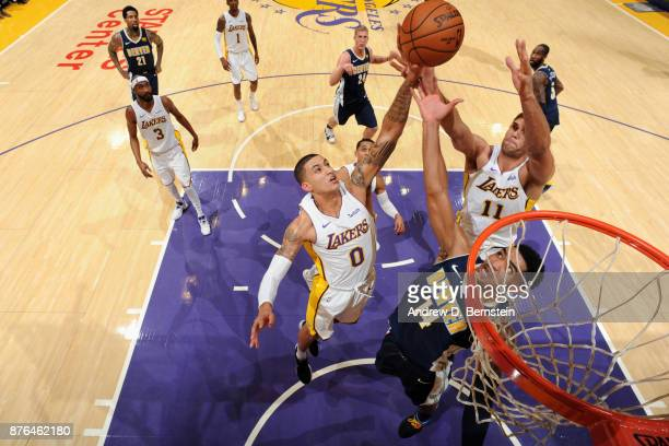 Kyle Kuzma Brook Lopez of the Los Angeles Lakers and Gary Harris of the Denver Nuggets jump for the rebound on November 19 2017 at STAPLES Center in...