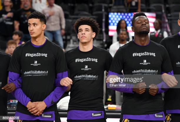 Kyle Kuzma Lonzo Ball and Julius Randle of the Los Angeles Lakers wear #VegasStrong Tshirts as they lock arms during a moment of silence held to...