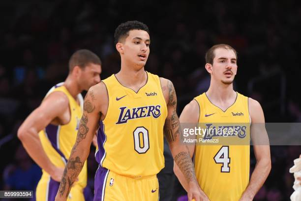 Kyle Kuzma of the Los Angeles Lakers and Alex Caruso of the Los Angeles Lakers look on during the preseason game against the Utah Jazz on October 10...
