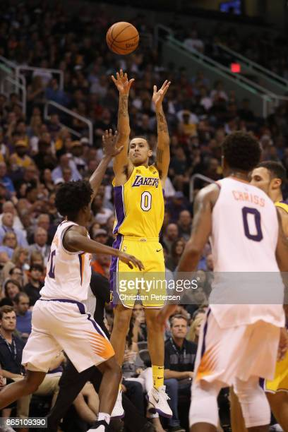 Kyle Kuzma of the Los Angeles Lakers attempts a shot against the Phoenix Suns during the NBA game at Talking Stick Resort Arena on October 20 2017 in...
