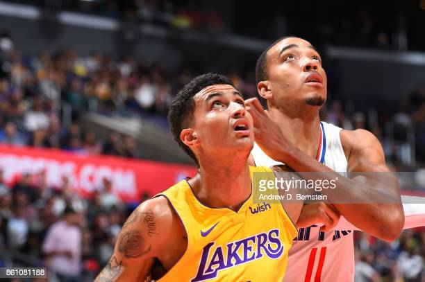 Kyle Kuzma of the Los Angeles Lakers boxes out against Brice Johnson of the LA Clippers on October 13 2017 at STAPLES Center in Los Angeles...