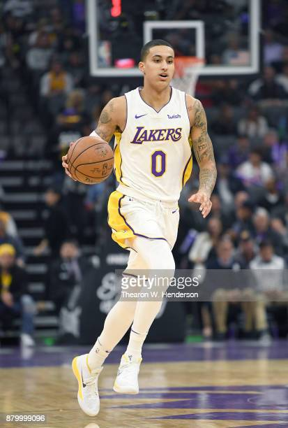 Kyle Kuzma of the Los Angeles Lakers dribbles the ball up court against the Sacramento Kings during their NBA basketball game at Golden 1 Center on...