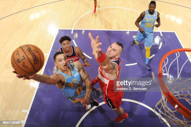 Kyle Kuzma of the Los Angeles Lakers drives to the basket against the Washington Wizards on October 25 2017 at STAPLES Center in Los Angeles...