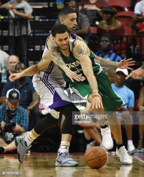 Kyle Kuzma of the Los Angeles Lakers fouls Abdel Nader of the Boston Celtics during the 2017 Summer League at the Thomas Mack Center on July 8 2017...