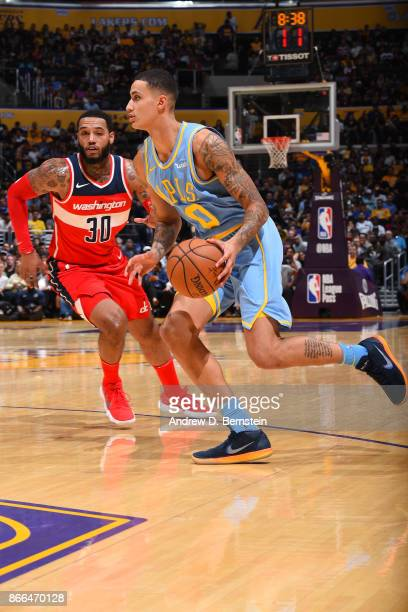 Kyle Kuzma of the Los Angeles Lakers handles the ball against the Washington Wizards on October 25 2017 at STAPLES Center in Los Angeles California...