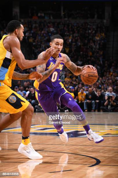 Kyle Kuzma of the Los Angeles Lakers handles the ball against the Denver Nuggets on December 2 2017 at the Pepsi Center in Denver Colorado NOTE TO...