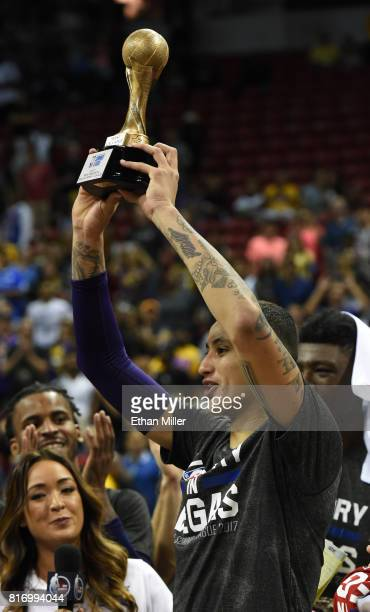 Kyle Kuzma of the Los Angeles Lakers holds up the championship game most valuable player trophy after the team beat the Portland Trail Blazers 11098...