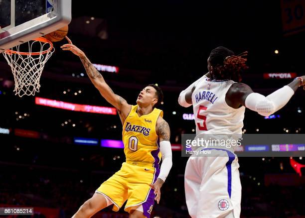 Kyle Kuzma of the Los Angeles Lakers is fouled as he drives to the basket on Montrezl Harrell of the LA Clippers during the first half at Staples...