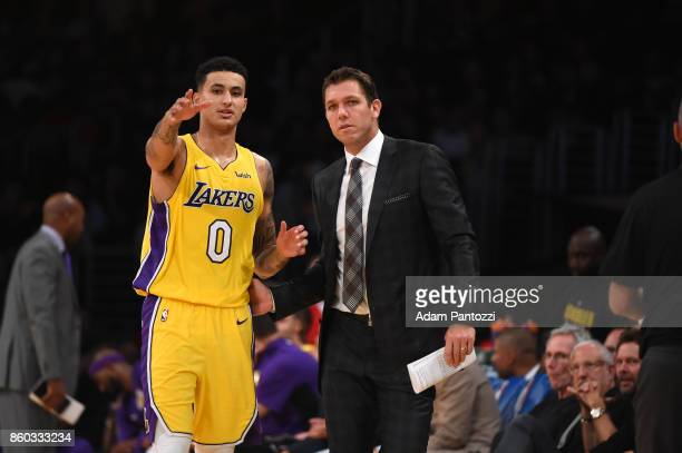 Kyle Kuzma of the Los Angeles Lakers looks on with Head coach Luke Walton of the Los Angeles Lakers during the preseason game against the Utah Jazz...