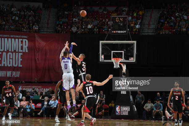 Kyle Kuzma of the Los Angeles Lakers scores a 3pointer and the end of the quarter during the game against the Portland Trail Blazers during the 2017...