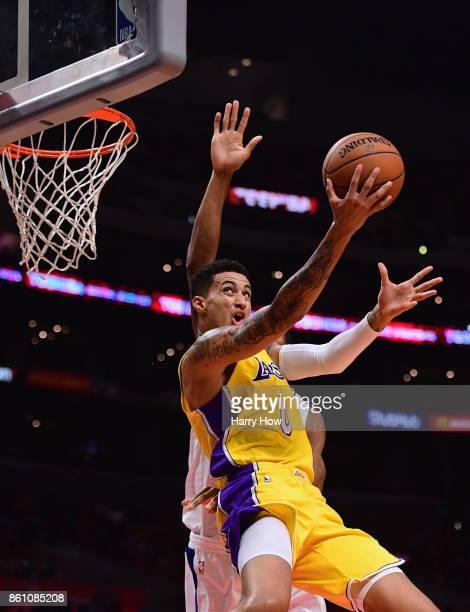 Kyle Kuzma of the Los Angeles Lakers scores on a reverse layup on Wesley Johnson of the LA Clippers during the first half at Staples Center on...