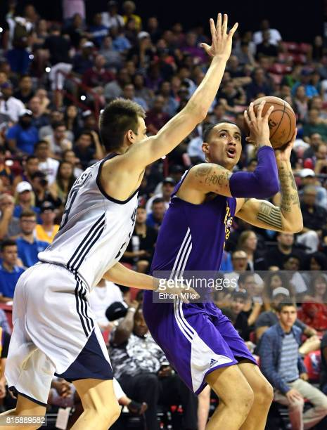 Kyle Kuzma of the Los Angeles Lakers shoots against Nicolas Brussino of the Dallas Mavericks during a semifinal game of the 2017 Summer League at the...