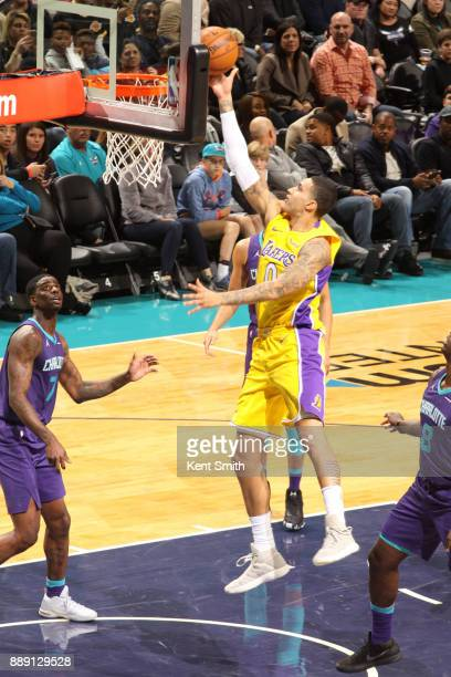 Kyle Kuzma of the Los Angeles Lakers shoots the ball against the Charlotte Hornets on December 9 2017 at the Spectrum Center in Charlotte North...