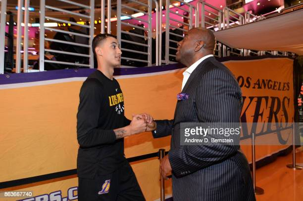 Kyle Kuzma of the Los Angeles Lakers talks with Magic Johnson before the game against the LA Clippers on October 19 2017 at STAPLES Center in Los...