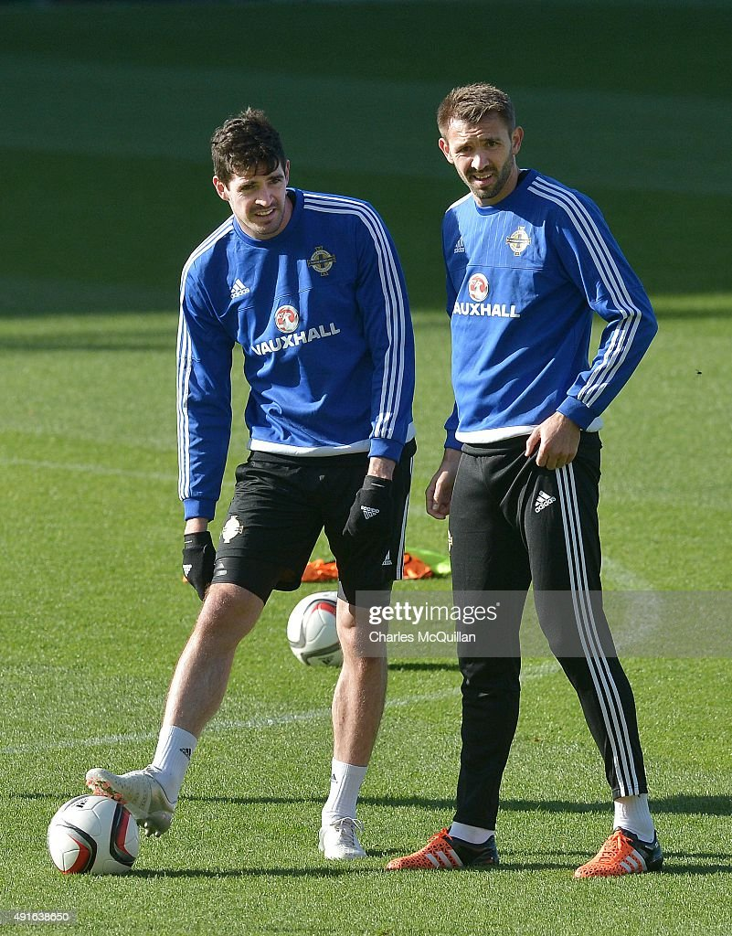 Kyle Lafferty (L) and Gareth McAuley (R) of Northern Ireland await instruction as the international football squad train at Windsor Park on October 7, 2015 in Belfast, Northern Ireland. Northern Ireland host Greece in a Euro 2016 Group F game at Windsor Park on Thursday evening.