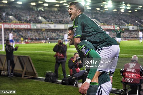 Kyle Lafferty celebrates his goal to put the home side 20 up with Jamie Ward during the Euro 2016 Qualifier between Northern Ireland and Faroe...