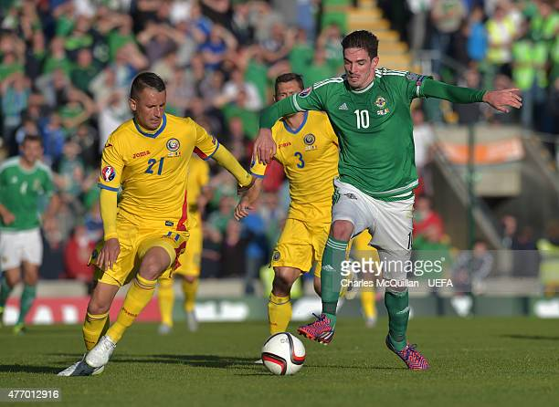 Kyle Lafferty of Northern Ireland and Dragos Grigos of Romania during the UEFA Euro 2016 Group F qualifier at Windsor Park on June 13 2015 in Belfast...