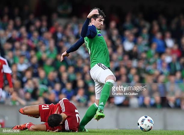 Kyle Lafferty of Northern Ireland and Egor Filipenko of Belarus during the international friendly game between Northern Ireland and Belarus on May 26...