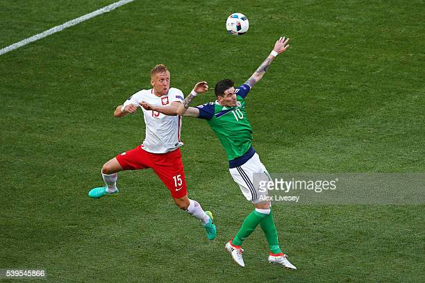 Kyle Lafferty of Northern Ireland and Kamil Glik of Poland compete for the ball during the UEFA EURO 2016 Group C match between Poland and Northern...