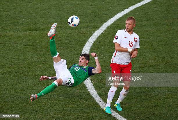 Kyle Lafferty of Northern Ireland attempts an overhead kick during the UEFA EURO 2016 Group C match between Poland and Northern Ireland at Allianz...