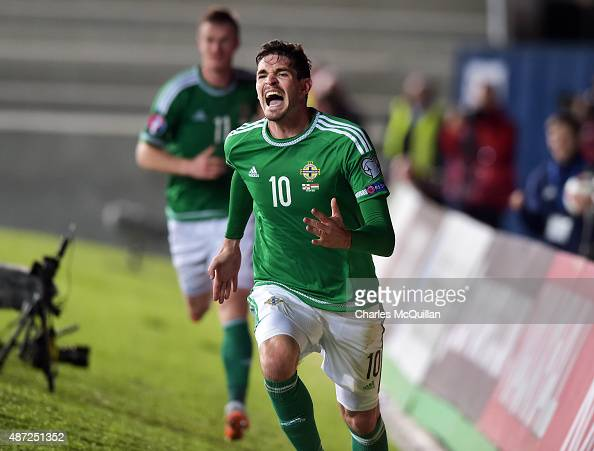Kyle Lafferty of Northern Ireland celebrates after scoring during the Euro 2016 Group F qualifying match between Northern Ireland and Hungary at...