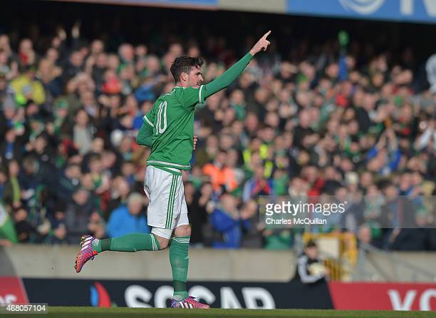 Kyle Lafferty of Northern Ireland celebrates after scoring his second goal during the EURO 2016 Group F qualifier at Windsor Park on March 29 2015 in...