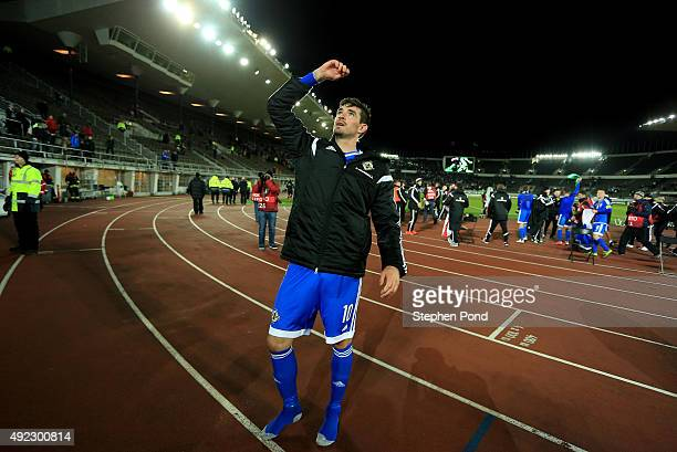 Kyle Lafferty of Northern Ireland celebrates after the UEFA EURO 2016 Qualifying match between Finland and Northern Ireland at the Olympic Stadium on...