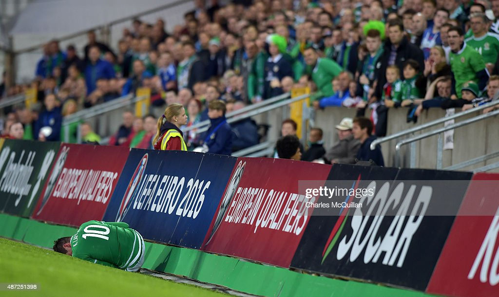 Kyle Lafferty of Northern Ireland lays injured during the Euro 2016 Group F qualifying match between Northern Ireland and Hungary at Windsor Park on September 7, 2015 in Belfast, Northern Ireland.