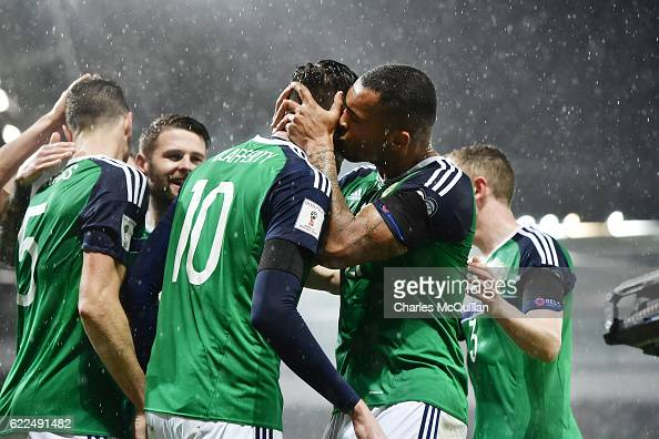 Kyle Lafferty of Northern Ireland receives a kiss from team mate Josh Magennis after he opened the scoring during the FIFA 2018 World Cup Qualifier...