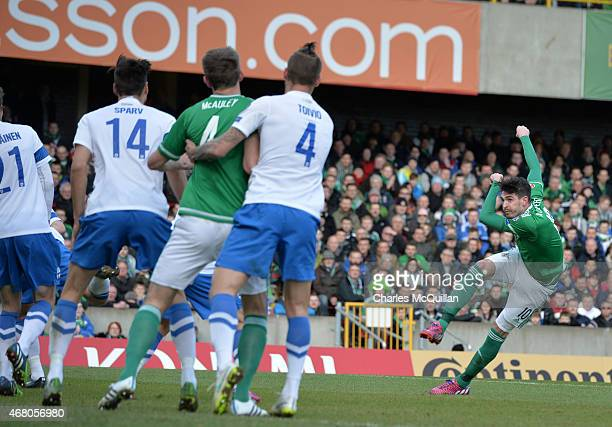 Kyle Lafferty of Northern Ireland scores during the EURO 2016 Group F qualifier at Windsor Park on March 29 2015 in Belfast Northern Ireland