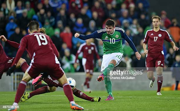 Kyle Lafferty of Northern Ireland sees his shot blocked during the international football friendly match between Northern Ireland and Latvia at...