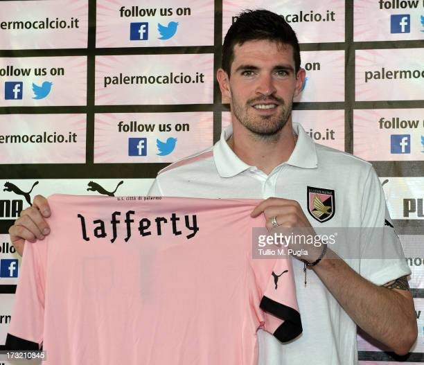 Kyle Lafferty poses during his presentation as new player of US Citta di Palermo at Tenente Carmelo Onorato Sports Center on July 10 2013 in Palermo...