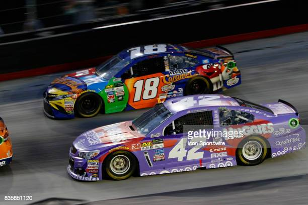 Kyle Larson Chip Ganassi Racing Huggies Little Movers Chevrolet SS and Kyle Busch Joe Gibbs Racing MMs Caramel Toyota Camry during the running of the...