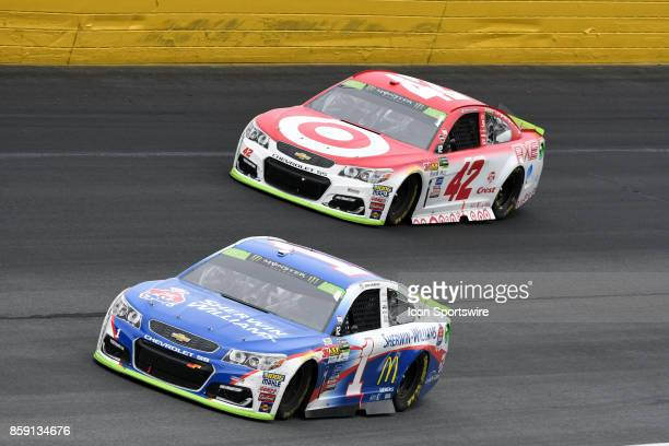 Kyle Larson Chip Ganassi Racing Target Chevrolet SS runs the high side just behind Jamie McMurray Chip Ganassi Racing SherwinWilliams Chevrolet SS...