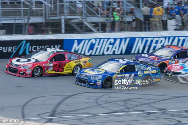 Kyle Larson driver of the Cars 3/Target Chevrolet and Chase Elliott driver of the NAPA Chevrolet lead the pack during the Monster Energy Cup Series...