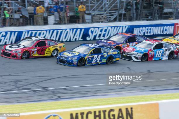 Kyle Larson driver of the Cars 3/Target Chevrolet Chase Elliott driver of the NAPA Chevrolet Kyle Busch driver of the MM'S Red White Blue Toyota and...