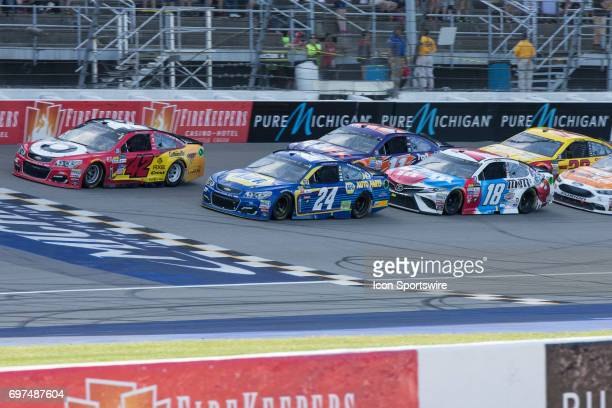 Kyle Larson driver of the Cars 3/Target Chevrolet Chase Elliott driver of the NAPA Chevrolet and Kyle Busch driver of the MM'S Red White Blue Toyota...