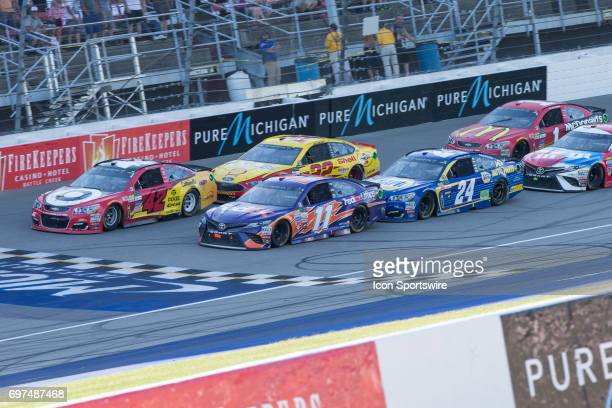 Kyle Larson driver of the Cars 3/Target Chevrolet Denny Hamlin driver of the FedEx Office Toyota Chase Elliott driver of the NAPA Chevrolet and Joey...