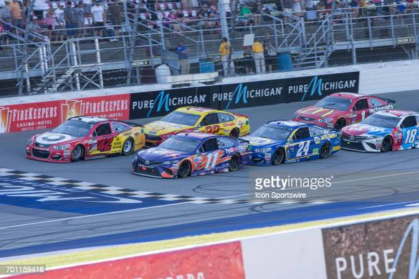 Kyle Larson driver of the Cars 3/Target Chevrolet Denny Hamlin driver of the FedEx Office Toyota Joey Logano driver of the Shell Pennzoil Ford Chase...
